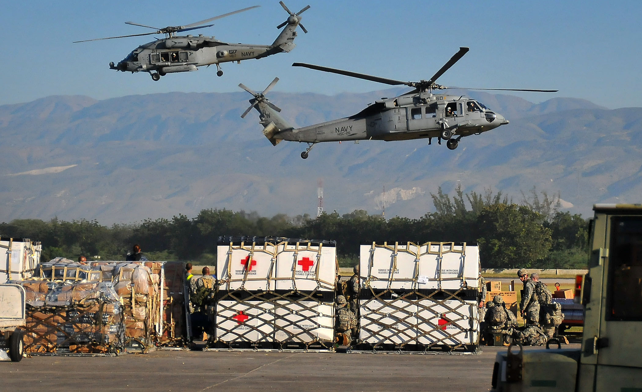 PORT-AU-PRINCE, Haiti  (Jan. 18, 2010) U.S. Navy SH-60F Sea Hawk helicopters from the Nimitz-class aircraft carrier USS Carl Vinson (CVN 70) transport water and supplies from the airport to areas around Port-au-Prince. Carl Vinson and Carrier Air Wing (CVW) 17 are conducting humanitarian and disaster relief operations as part of Operation Unified Response after a 7.0 magnitude earthquake caused severe damage near Port-au-Prince on Jan. 12, 2010. (U.S. Navy photo by Mass Communication Specialist 2nd Class Daniel Barker/Released)