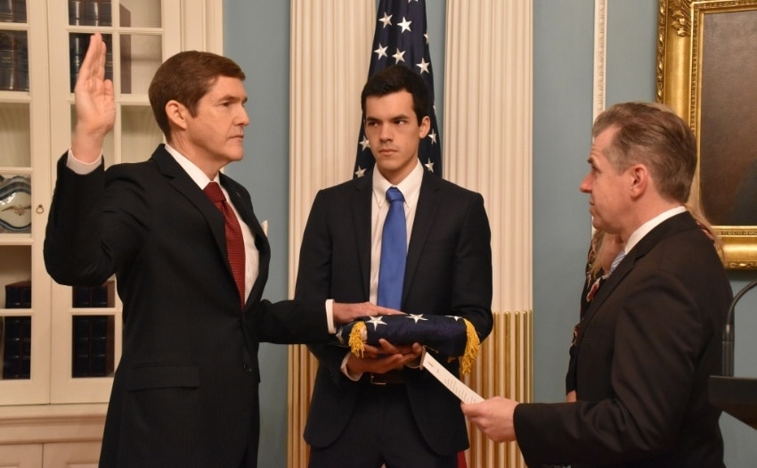 Ambassador Earl Miller is sworn in by Ambassador Sean Lawler as the next U.S. Ambassador to the People's Republic of Bangladesh as his son Alexander looks on, November 13, 2018. (U.S. Department of State photo)