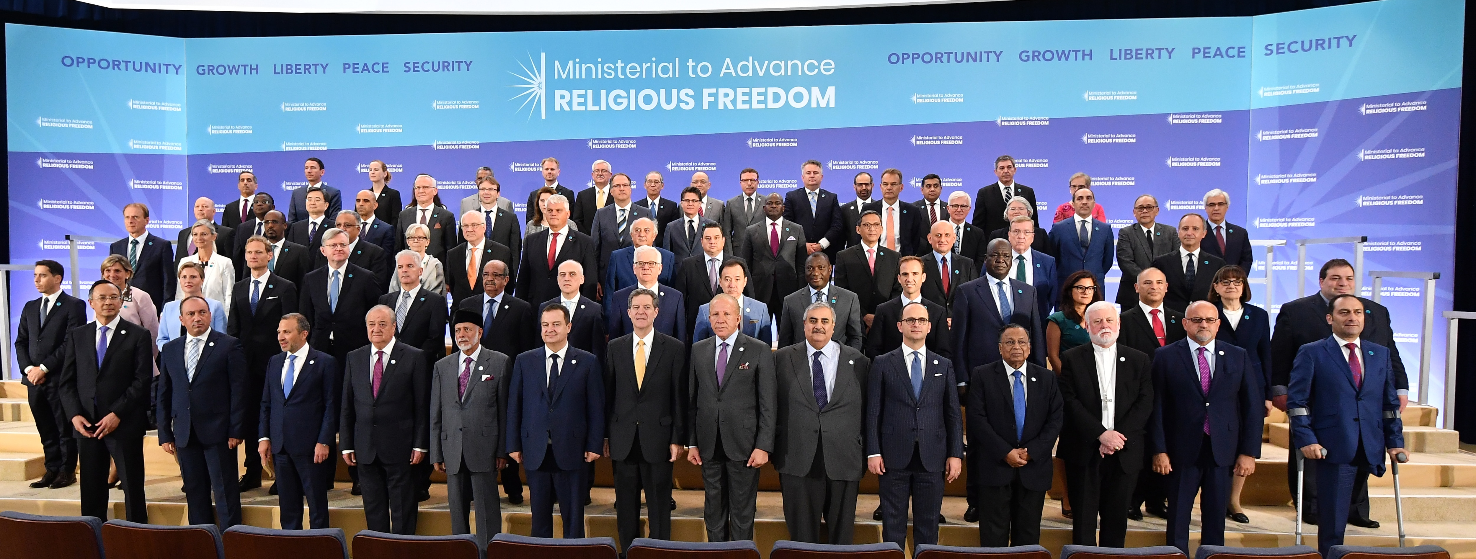 Ambassador Brownback and all Delegates pose for a family photo at the Ministerial to Advance Religious Freedom at the U.S. Department of State in Washington, D.C. on July 26 2018. [State Department Photo/Public Domain]
