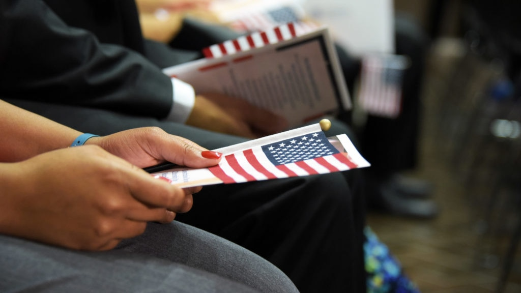 Flags held during a naturalization ceremony