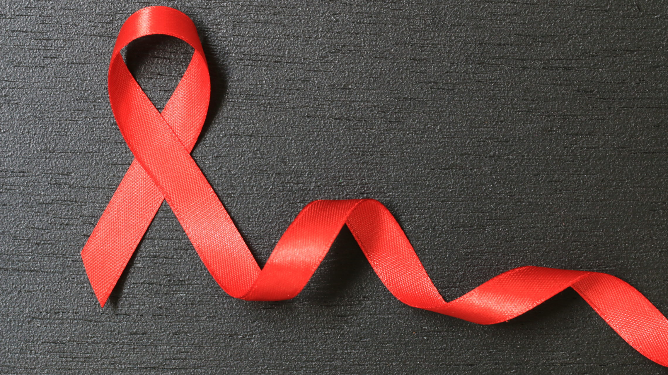 Red Ribbon. Aids Awareness. World Aids Day concept. - Image