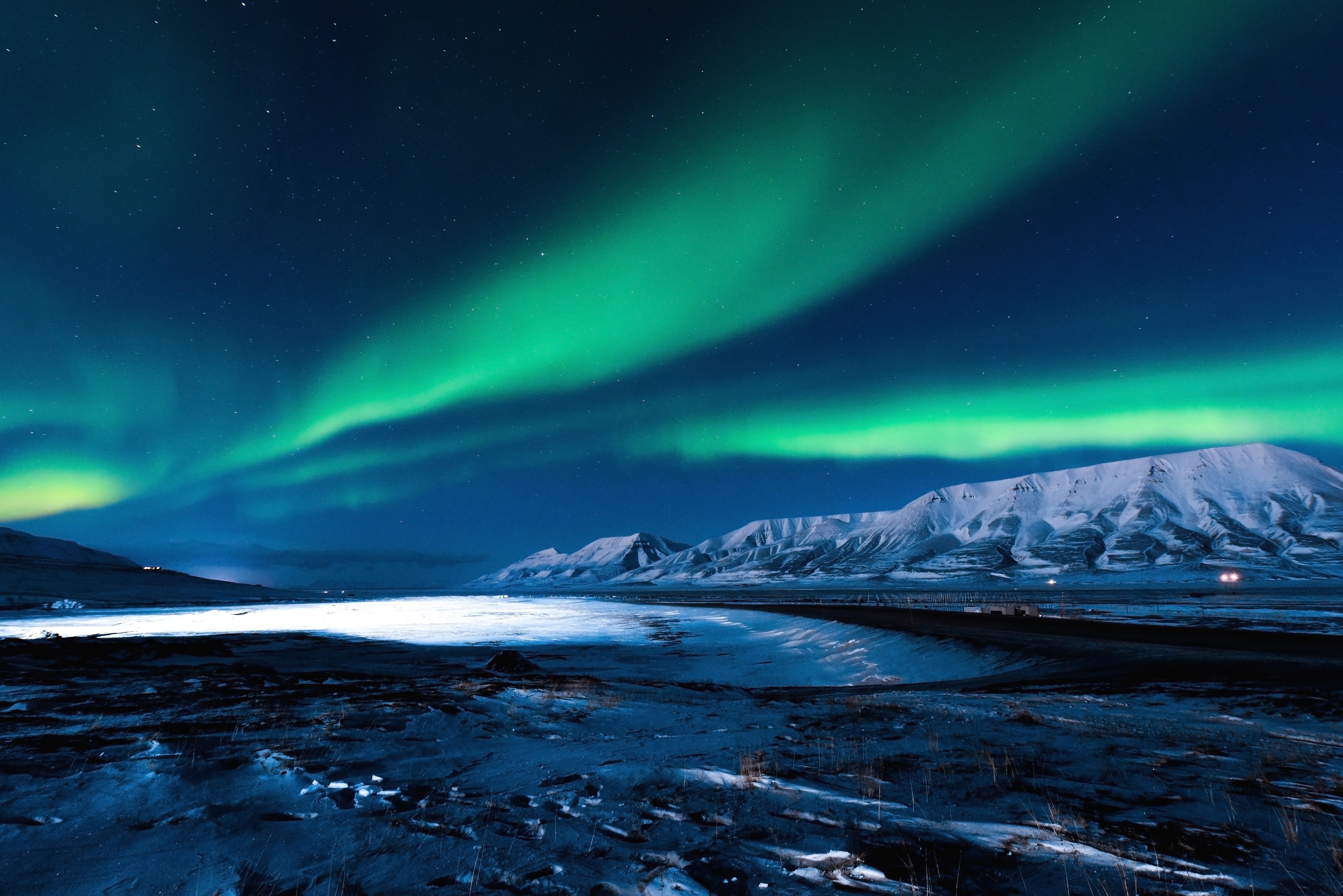 The polar Northern lights in Norway Svalbard in the mountains - Image [Shutterstock]