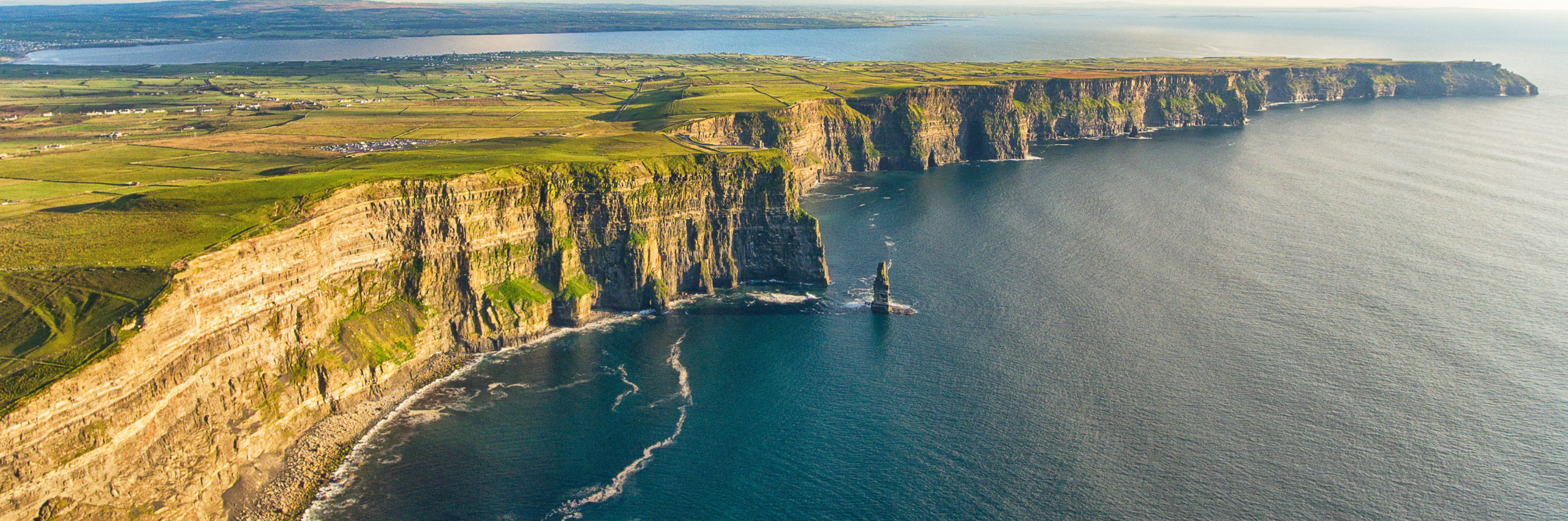 Aerial birds eye drone view from the world famous cliffs of moher in county clare ireland. Scenic Irish rural countryside nature along the wild atlantic way and European Atlantic Geotourism Route - Image [Shutterstock]