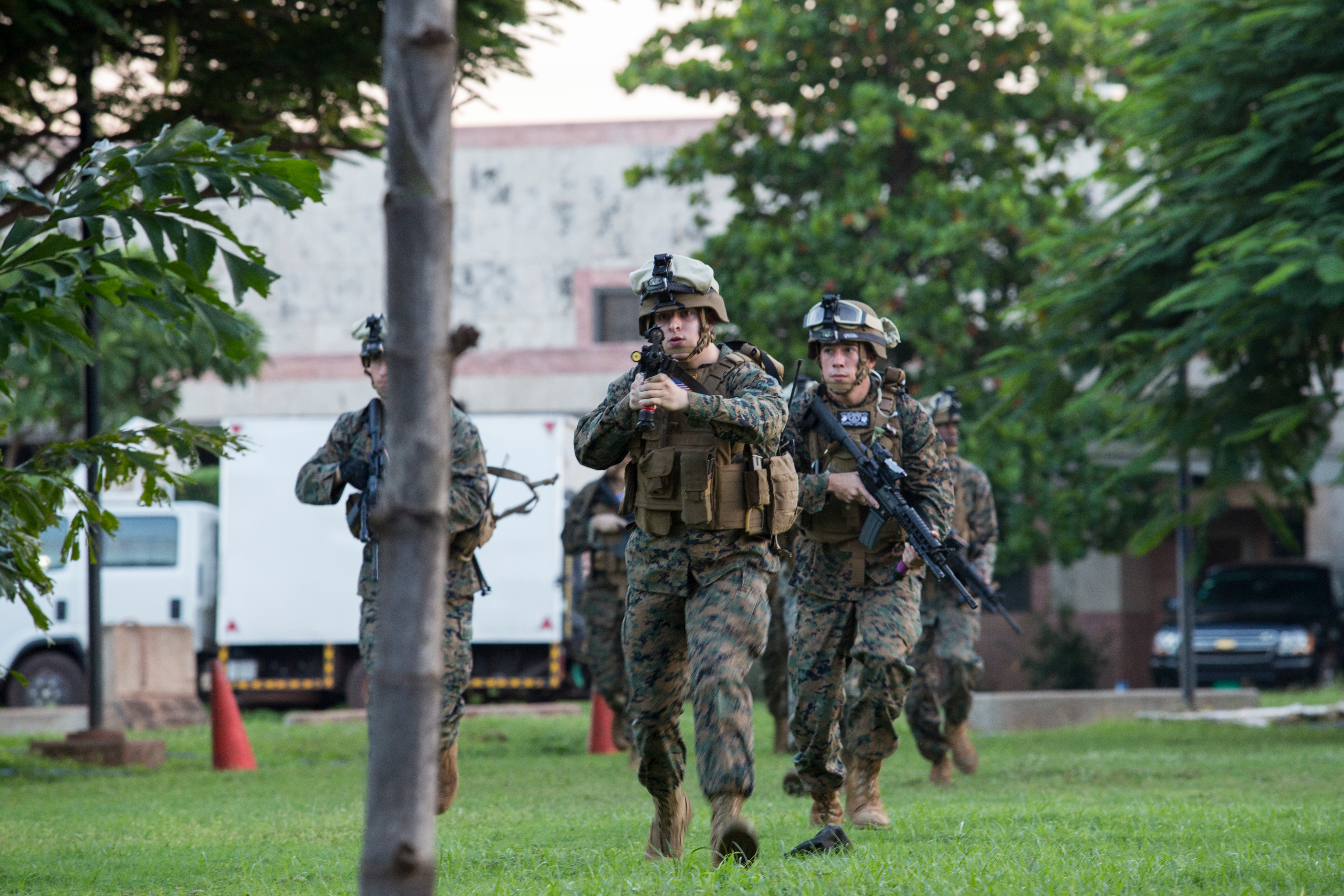 U.S. Marine Security Guard (MSG) watchstanders perform a drill outside of the Marine House near the U.S. Embassy, Bamako, Mali, Aug. 29, 2016. The MSG program, run by the Marine Corps Embassy Security Group, has 175 Marine Corps Detachments throughout the world, providing protection to mission personnel and to prevent the compromise of national security information and equipment at designated diplomatic and consular facilities. (U.S. Marine Corps photo by Staff Sgt. Sarah R. Hickory)