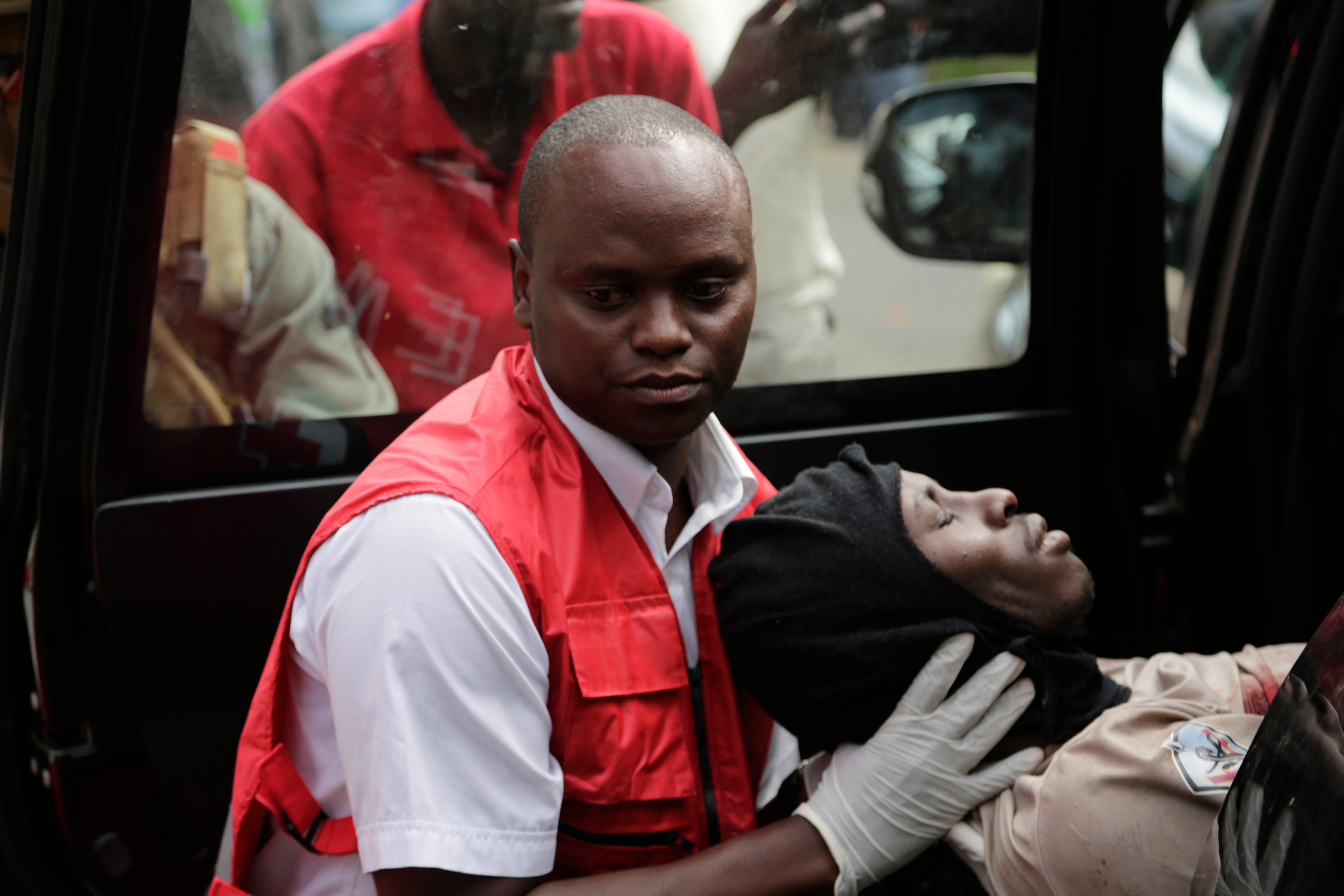 A wounded member of Kenyan special forces is carried from a US embassy diplomatic vehicle into an ambulance by red cross paramedics at the scene Wednesday, Jan. 16, 2019 in Nairobi, Kenya. Extremists stormed a luxury hotel in Kenya's capital on Tuesday, setting off thunderous explosions and gunning down people at cafe tables in an attack claimed by Africa's deadliest Islamic militant group (AP Photo/Khalil Senosi) A wounded officer with the U.S. embassy's Special Program for Embassy Augmentation Response (SPEAR) team is loaded into an ambulance after being hit by grenade fragments while responding to the attack at the DusitD2 Hotel, January 16, 2019, in Nairobi. SPEAR team members are trained and equipped by the Antiterrorism Assistance program to respond to crises involving the U.S. embassy and are also available to assist in other emergencies. (AP/WideWorld Photos)