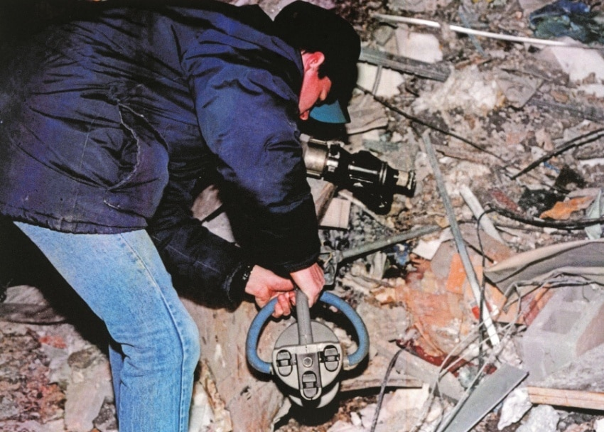 A DSS Agent operates an explosives detector inside a crater left by the 1993 World Trade Center bombing. Source: Bureau of Alcohol, Tobacco, and Firearms.