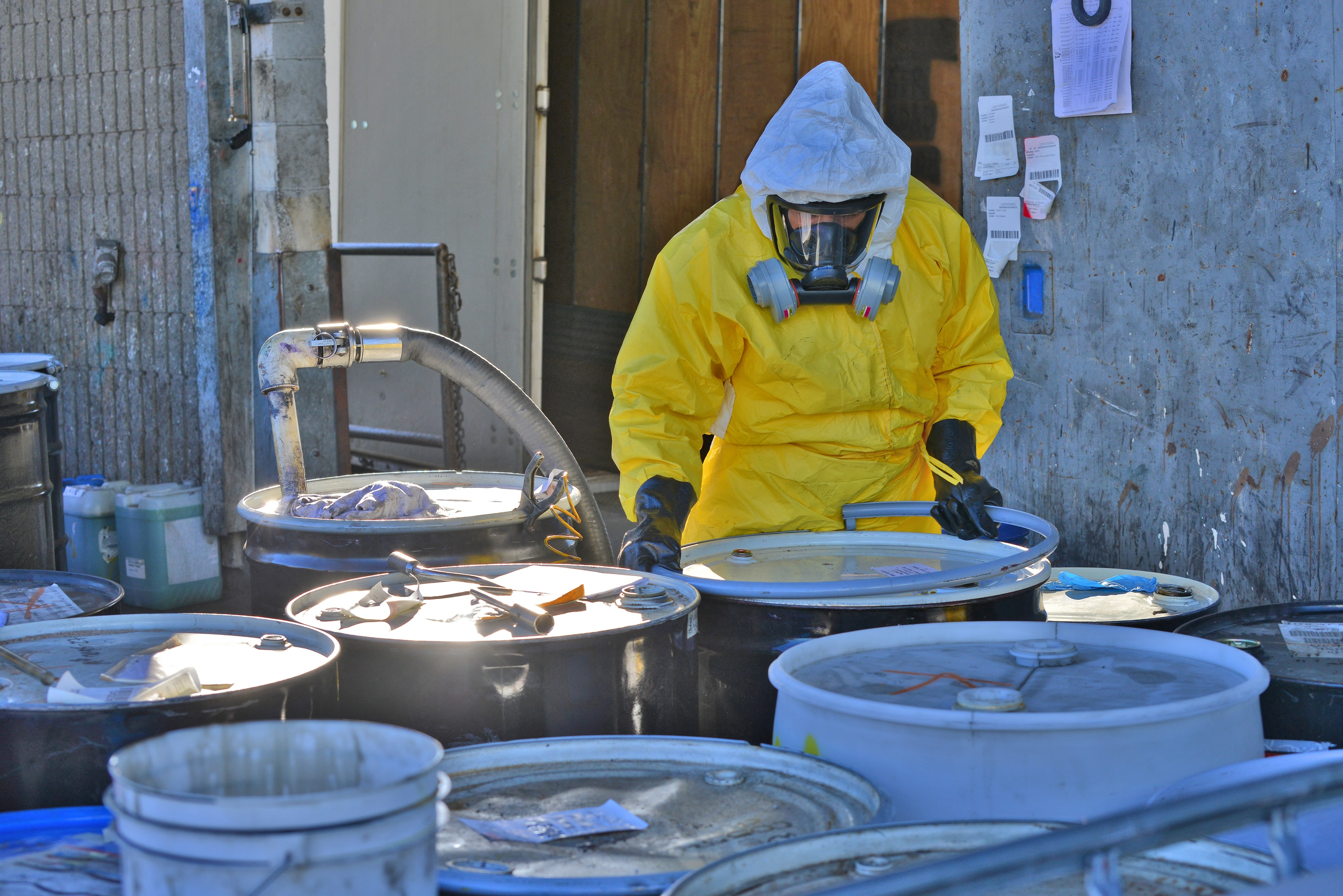 Man handling toxic waste - Image
