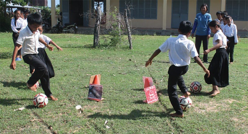 Date: 2019 Description: Children in Cambodia play a soccer game that also teaches MRE. © Photo courtesy of SoS