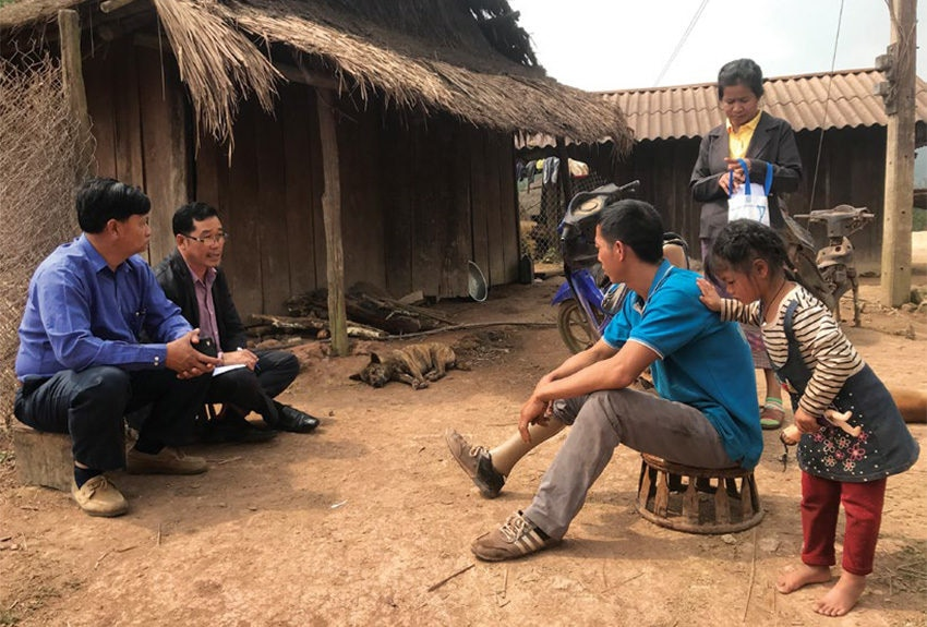 Date: 2019 Description: A World Education Victim Assistance Support Team meets with a UXO survivor and his family in Xieng Khouang Province, Laos. © Photo courtesy of World Education