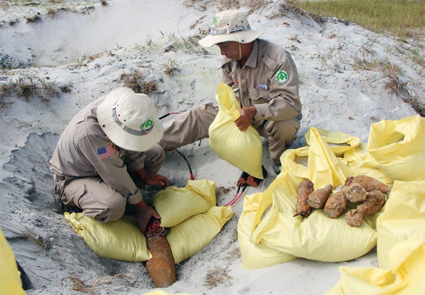 Date: 2019 Description: In Vietnam, a survey team prepares to destroy UXO items recovered from the surrounding community. © Photo courtesy of NPA.