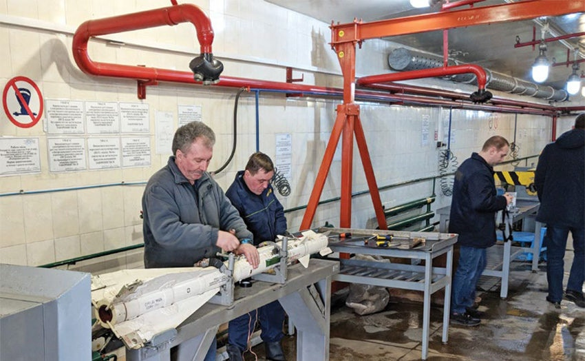 Date: 2019 Description: Workers at the Hrecheny factory in Ukraine disassembling Soviet era air-to-air missiles. © Photo by NSPA