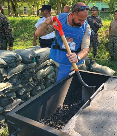 Date: 2019 Description: Small arms ammunition is prepared for incineration in El Salvador. © Photo courtesy of HALO