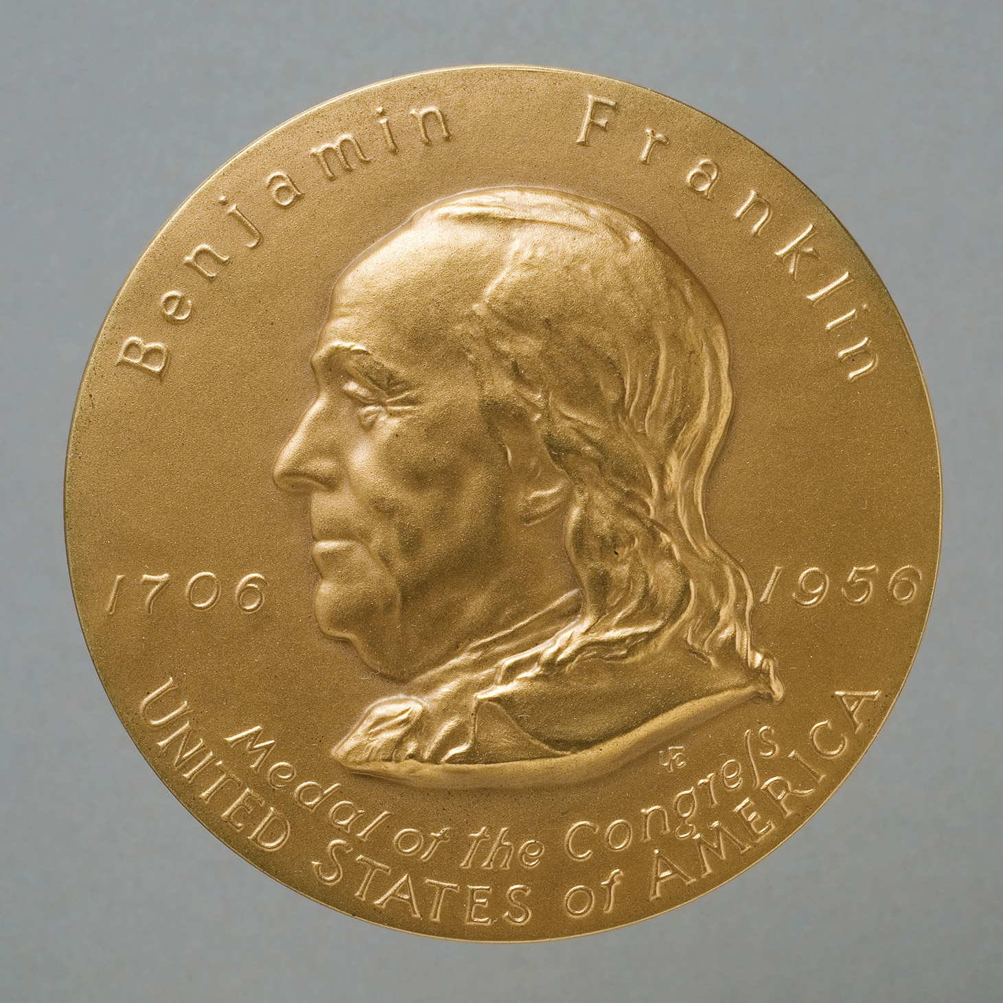 Photo showing the Benjamin Franklin Medal of the Congress, 1956. It was struck in honor of the 250th anniversary of Franklin's birth and distributed to organizations which are part of Franklin's legacy. [Department of State]