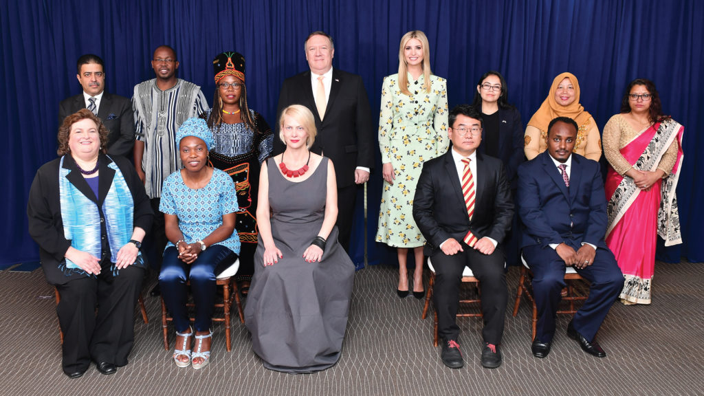Photo showing Secretary Pompeo, Ivanka Trump (center right), and Acting Director of the Office to Monitor and Combat Trafficking in Persons Kari Johnstone (front far left) posing with the 2018 'TIP Report Heroes' in Washington D.C., June 28, 2018. [Department of State]