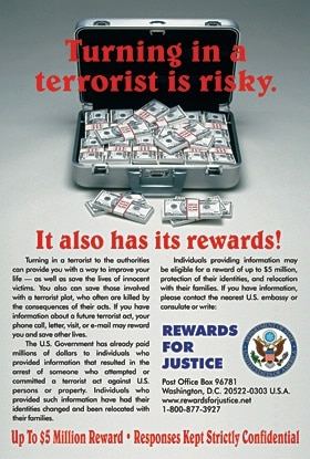 Photo of a poster used in the rewards for justice program, that presents a briefcase full of cash with the words 'Turning in a terrorist is risky. It also has its rewards! Up to $5 million reward. Responses kept strictly confidential.'