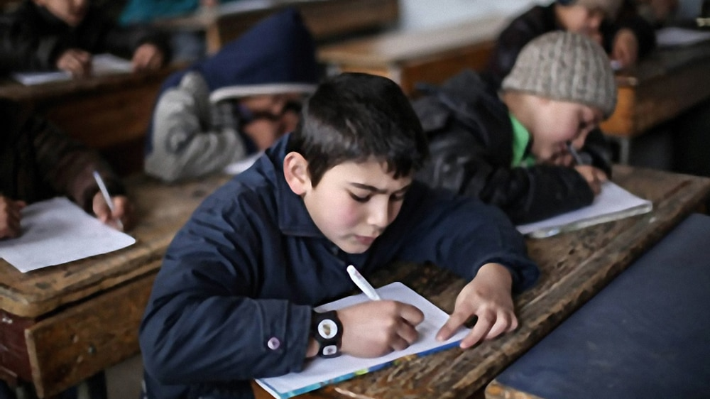 Photo showing school children taking exams at a Department-funded school in Idlib, Syria. [Chemonics International]