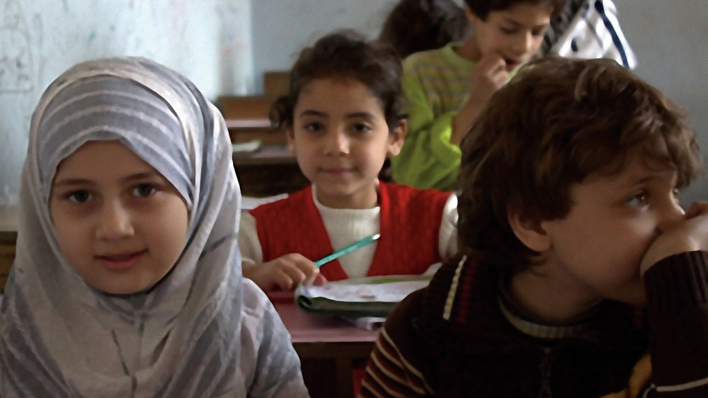 Photo showing Syrian students engaging in a dialogue session sponsored by the Aleppo Education Directorate in Aleppo, Syria. [Chemonics International]