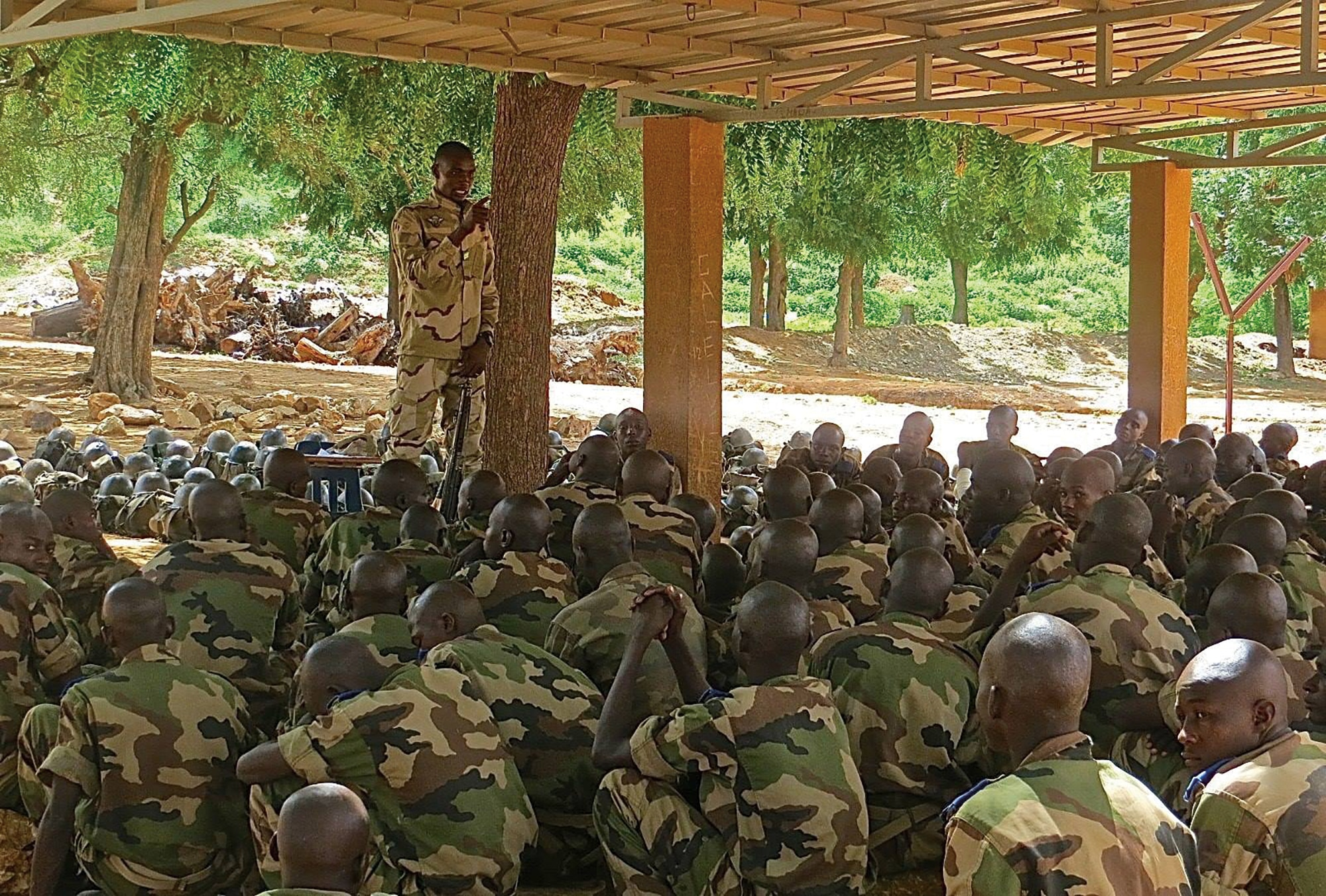 Photo showing Nigerien recruits undergoing training at the newly constructed outdoor classrooms located in Tondibiah, Niger. [Department of State]