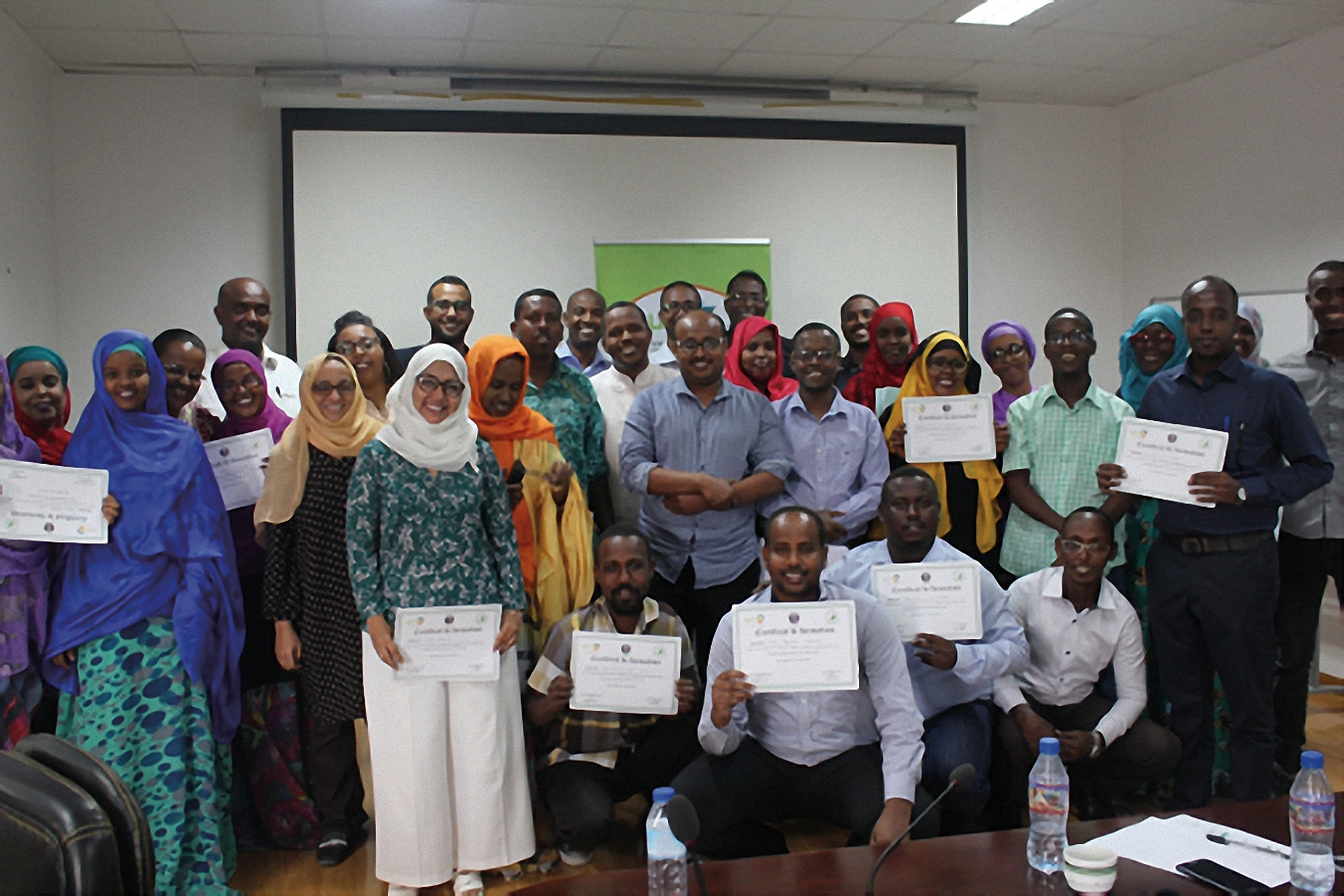 Photo showing Community Change Agents participants showcasing their training certificates after completing the regional exchange program in Djibouti City, Djibouti, August 2018. [Uganda Muslim Youth Development Forum]
