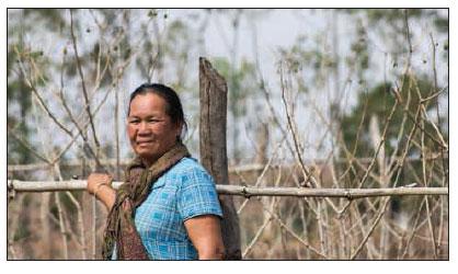 Date: 2018 Description: Boua Li on her plot of farmland. © Photo courtesy of MAG