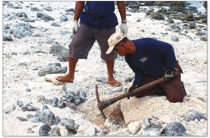 Date: 2018 Description: A Golden West team, funded by PM/WRA, carefully excavates a WWII Japanese aerial bomb used as an improvised beach mine in Wotje atoll in the Solomon Islands. © Photo courtesy of Golden West