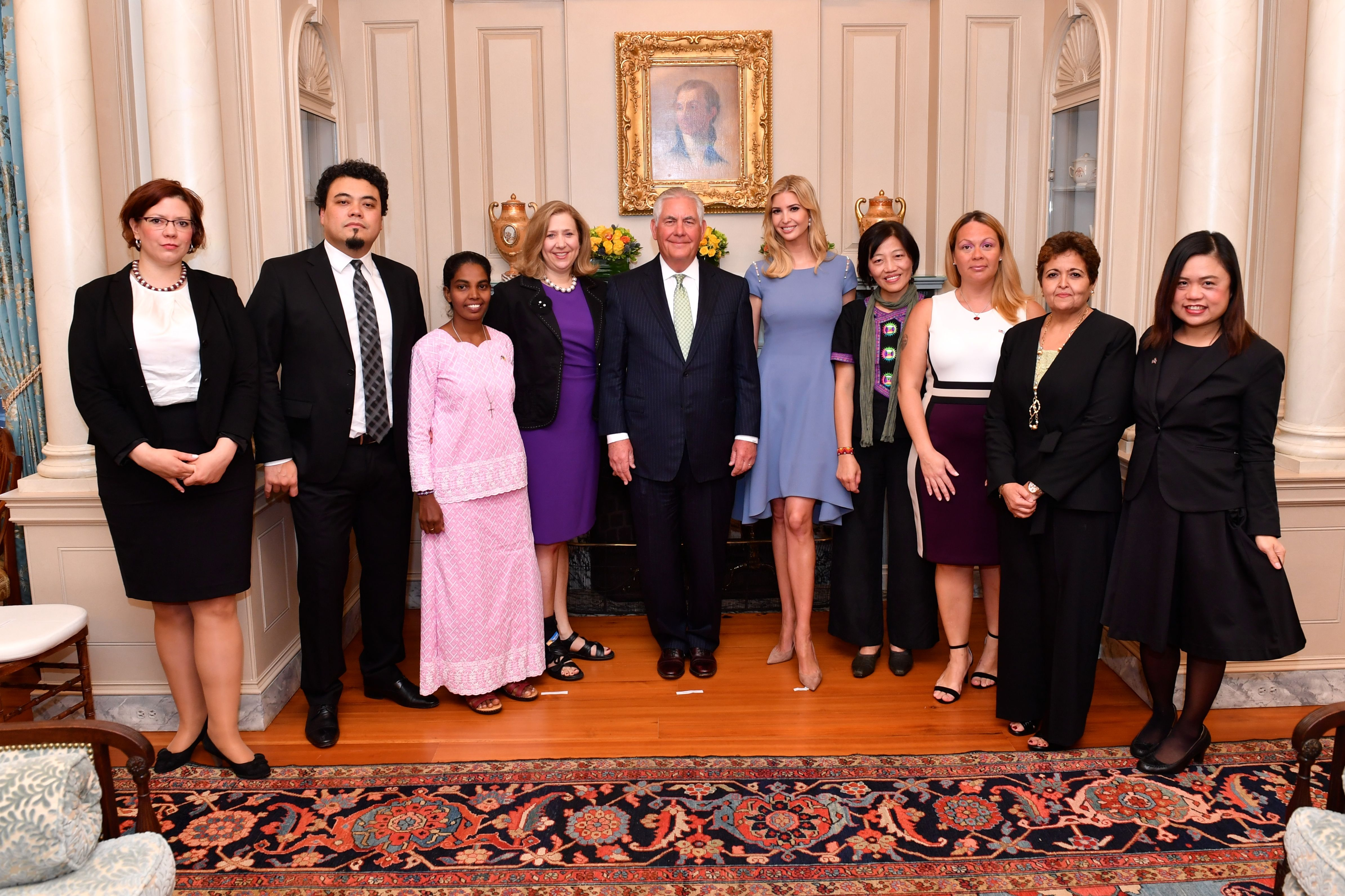 U.S. Secretary of State Rex Tillerson, Advisor to the President Ivanka Trump and Ambassador-at-Large to Monitor and Combat Trafficking in Persons and Senior Advisor to the Secretary of State Susan Coppedge pose for a photo with the 2017 Trafficking in Persons Heroes at the U.S. Department of State in Washington, D.C., on June 27, 2017. The 2017 TIP Heroes are Alika Kinan of #Argentina, Leonardo Sakamoto of #Brazil, Vanaja Jasphine of #Cameroon, Viktoria Sebhelyi of #Hungary, Mahesh Muralidhar Bhagwat of #India, Amina Oufroukhi of #Morocco, Allison Lee of #Taiwan, and Boom Mosby of #Thailand. [State Department photo/ Public Domain]