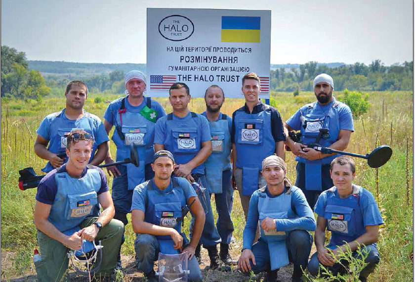 Date: 2018 Description: Ethan Rinks (second from right, top row) PM/WRA program manager for CWD in Europe, visits a HALO demining team in Ukraine funded by PM/WRA. © Photo courtesy of HALO
