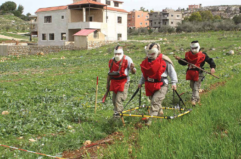 Date: 2018 Description: DCA deminers, funded by PM/WRA, use a large loop detector to conduct sub-surface clearance in Lebanon. © Photo courtesy of DCA