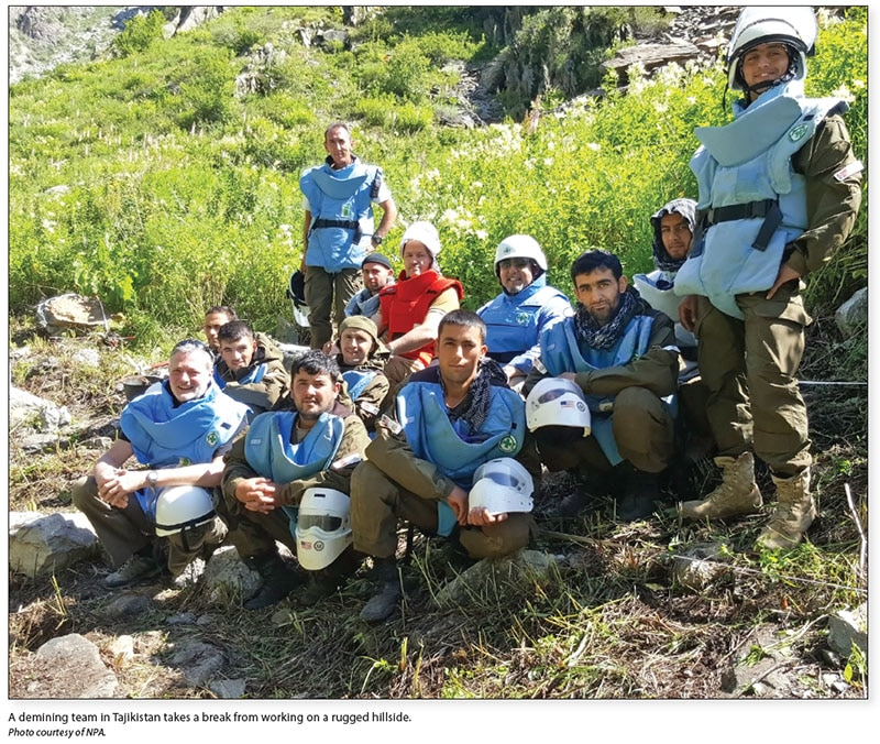 Date: 2017 Description: A demining team in Tajikistan takes a break from working on a rugged hillside. © Photo courtesy of NPA.