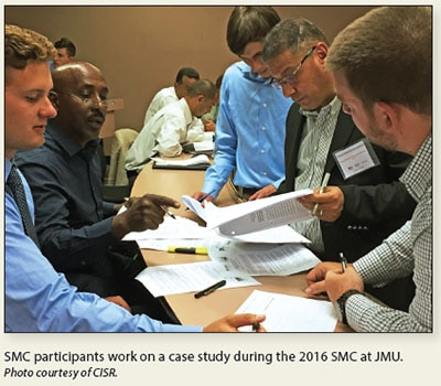 Date: 2017 Description: SMC participants work on a case study during the 2016 SMC at JMU. © Photo courtesy of CISR.