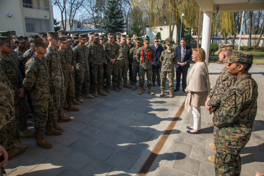 U.S. Ambassador Anne Hall (right, tan shawl) welcomes the Fleet Anti-Terrorism Security Team (FAST) Company Europe to U.S. Embassy Vilnius on April 1, 2019. (U.S. Department of State photo)