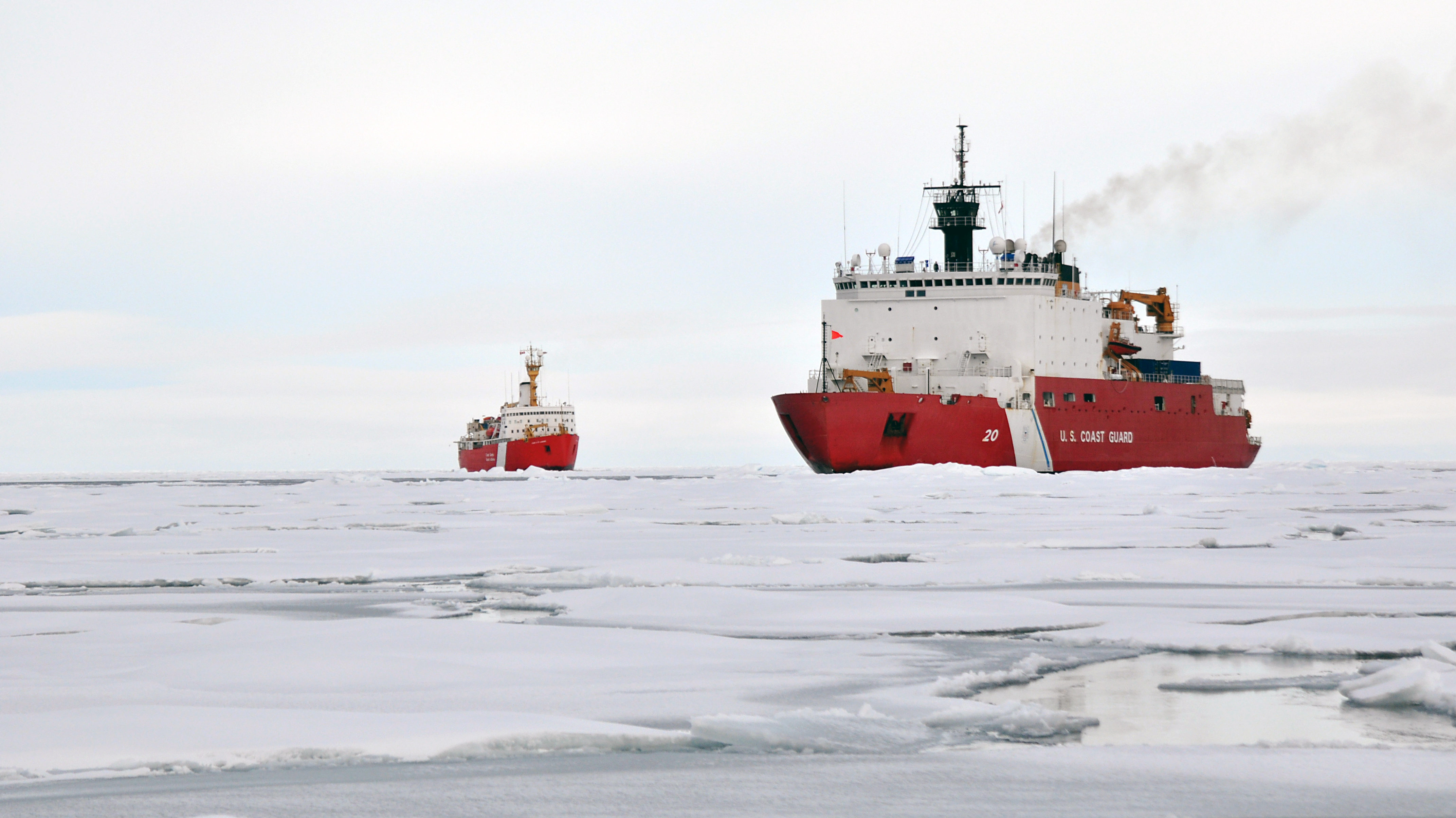 the U.S. Coast Guard Cutter Healy and the Canadian Coast Guard Cutter Louis S Saint Laurent operating in Arctic sea ice, as seen from the ice level