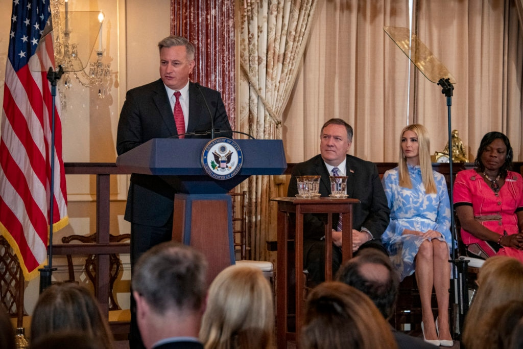 John Richmond, Ambassador for Trafficking In Persons in the Office to Monitor and Combat Trafficking in Persons, flanked by U.S. Secretary of State Michael R. Pompeo and Advisor to the President Ivanka Trump delivers closing remarks at an event recognizing the release of the 2019 Trafficking in Persons report and honoring the 2019 'TIP Report Heroes' at the U.S. Department of State in Washington, DC on June 20, 2019.