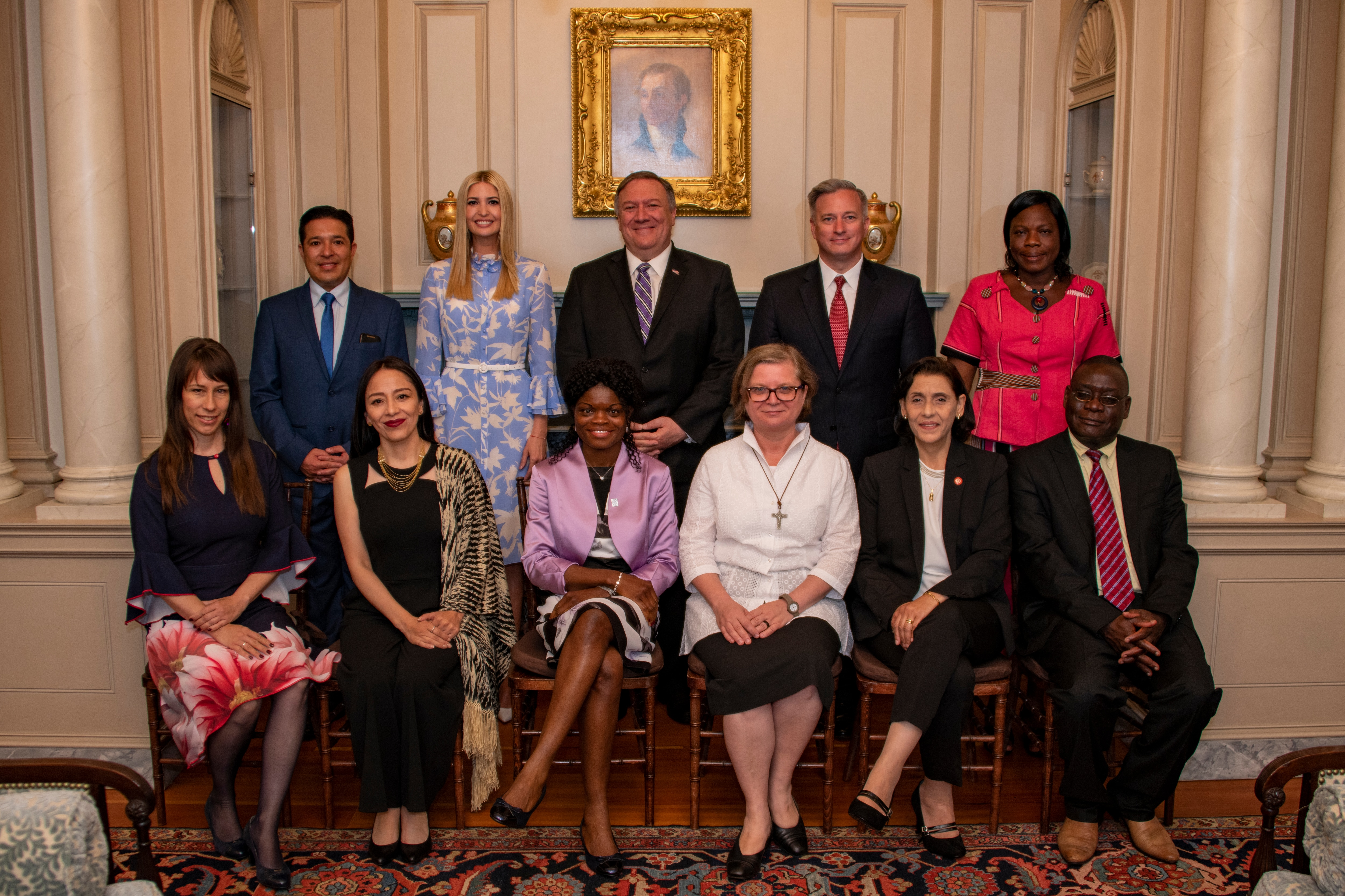 U.S. Secretary of State Michael R. Pompeo (center), Advisor to the President Ivanka Trump (center left), and Ambassador for Trafficking In Persons John Richmond of the Office to Monitor and Combat Trafficking in Persons (center right) pose for a group photo with the 2019 'TIP Report Heroes' at the U.S. Department of State, in Washington, DC on June 20, 2019.