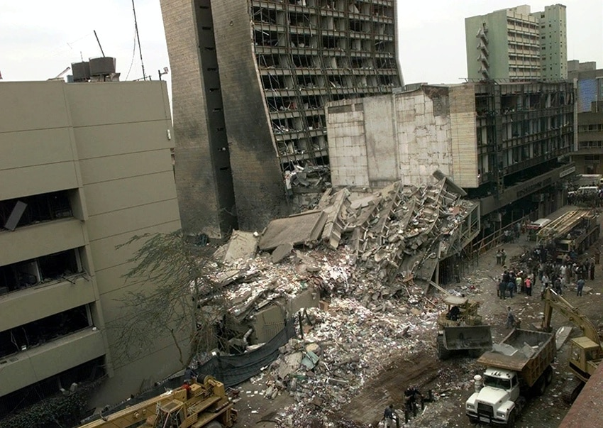 The U.S. Embassy (left) is pictured with blasted ruins next to it in downtown Nairobi, Kenya, August 8, 1998, one day after terrorist bombs exploded at the U.S. embassies in Kenya and Dar es Salaam, Tanzania. (AP/Wide World Photos)