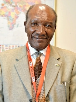 In this July 2015 photo, Stanley Macharia wears an ID badge lanyard identifying him as a survivor of the 1998 U.S. embassy bombing in Nairobi, Kenya.(U.S. Department of State photo)