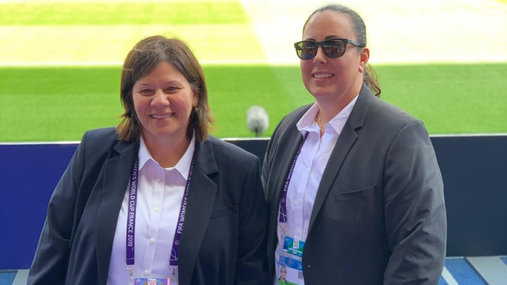 Two DSS special agents embedded with the U.S. women's soccer team stop for a quick photo as they inspect one of the tournament venues for potential threats, Paris, France, June 16, 2019. (U.S. Department of State photo)