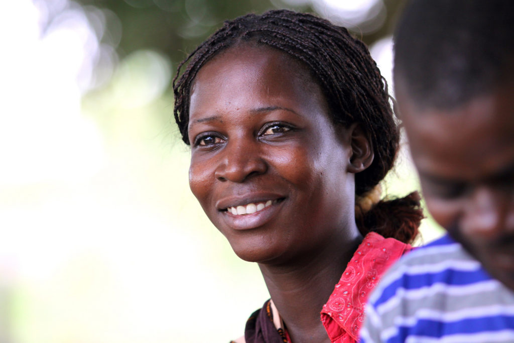 A Smiling Women Supported By PEPFAR In Mozambique