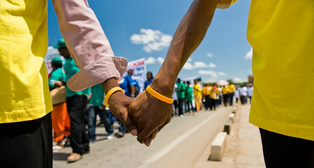 Men Holding Hands In Mozambique