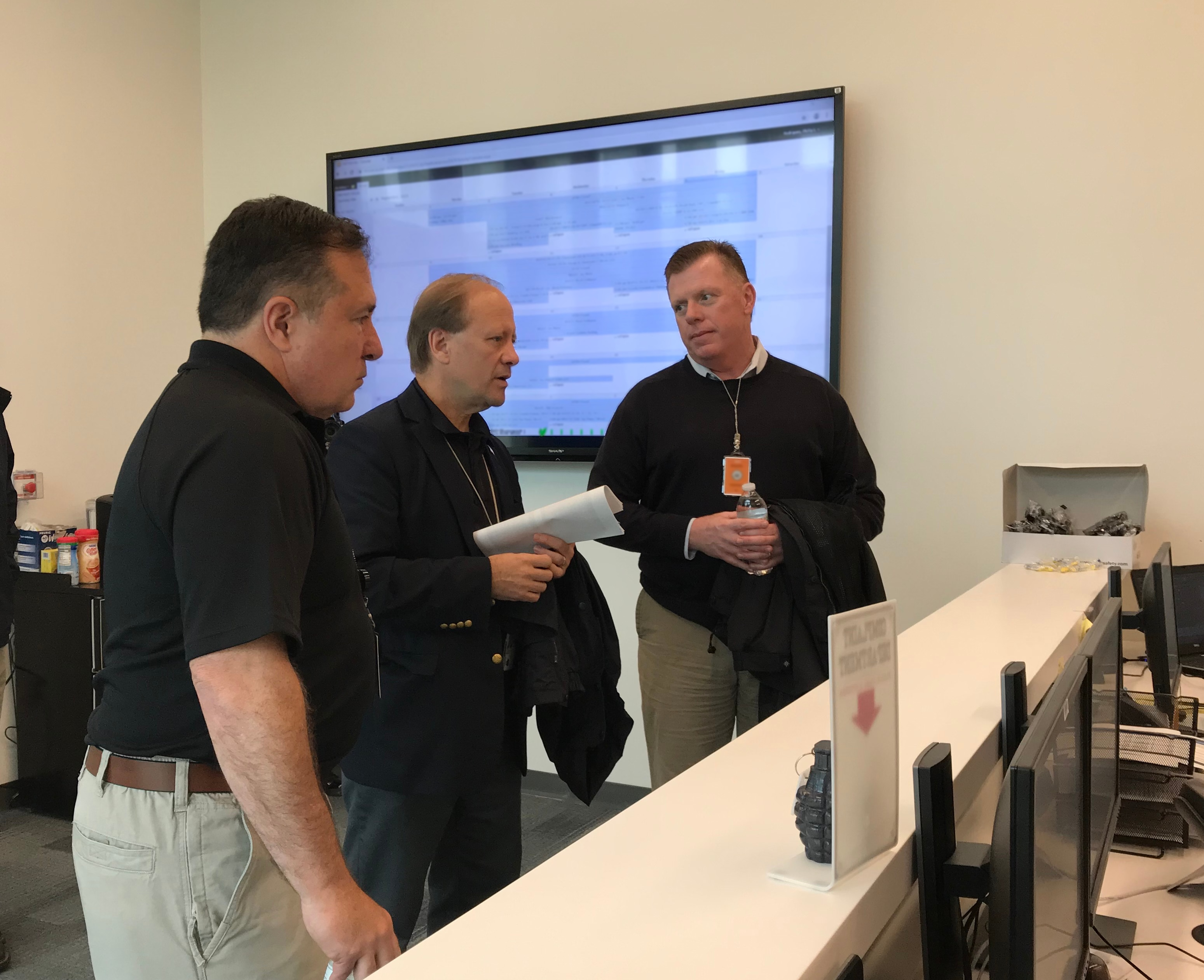 (Left to right) Assistant Secretary for Diplomatic Security Michael Evanoff, FASTC Director Robert Weitzel and Director of the U.S. Secret Service James Murray begin a tour of FASTC in the facility's Tactical Operations Center.