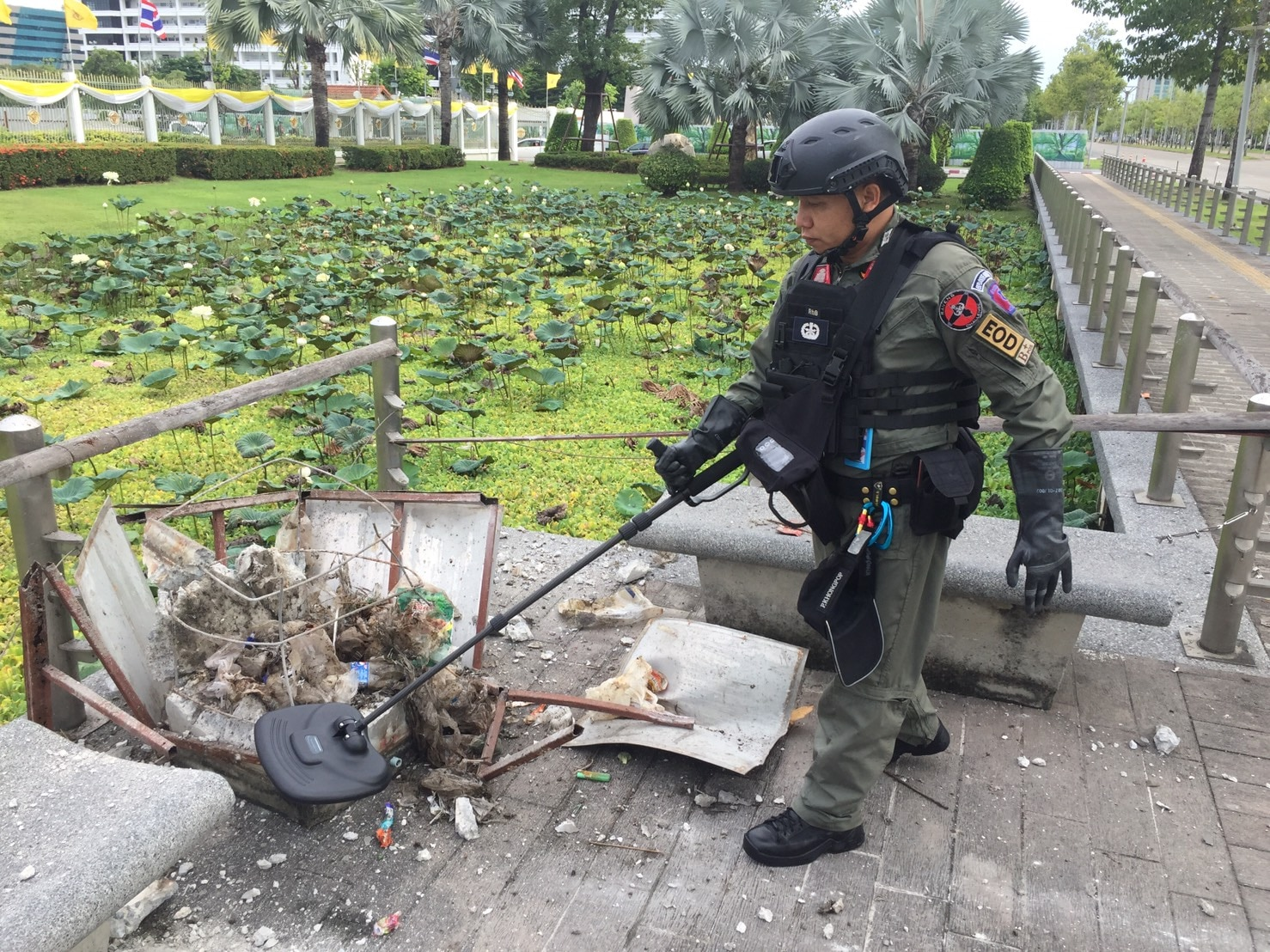 An ATA-trained bomb tech with the Royal Thai Police Metropolitan Police Bureau uses a nonlinear junction detector to scan for components of a detonated IED at a blast site in Bangkok on August 2, 2019. (Photo courtesy of Royal Thai Police)
