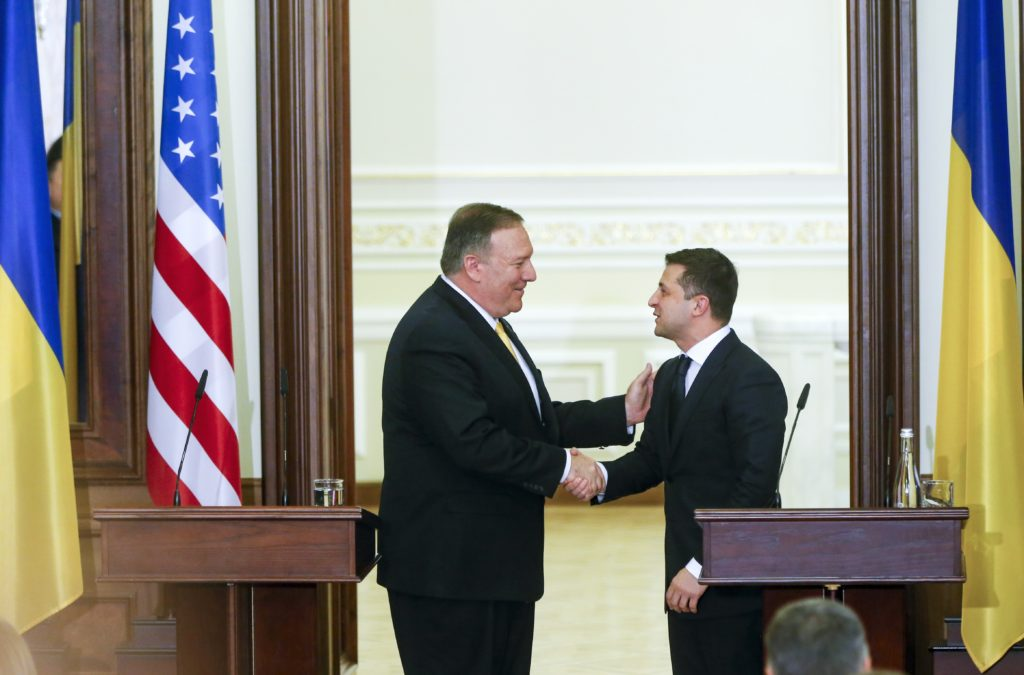 Secretary of State Mike Pompeo, left, and Ukrainian President Volodymyr Zelenskyy talk to each other after a joint news conference following their talks in Kyiv, Ukraine, January 31, 2020.