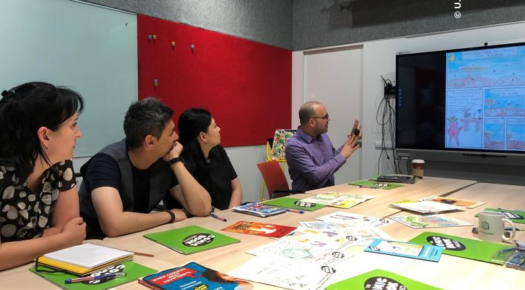 Dr. Michael Bitz, creator of world-renowned literacy initiative, The Comic Book Project, facilitating workshops for community leaders in Kazakhstan on designing and publishing comic books.