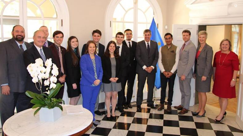 2019 Schuman Challenge teams, EU Delegation Officials, and DAS Fisher pose for a group photo.