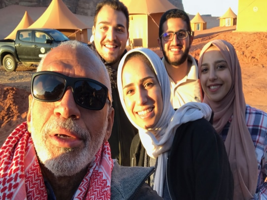 U.S. Science Envoy for Space Charlie Bolden in the Wadi Rum desert in Jordan—filming location for The Martian—poses for a selfie with winners of a local contest.