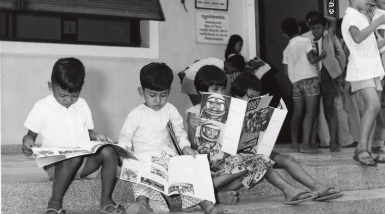State and USIA worked to ensure the world was well aware of the U.S. space program. This was accomplished through the sharing of education material and literature as seen at the USIA library in Cambodia