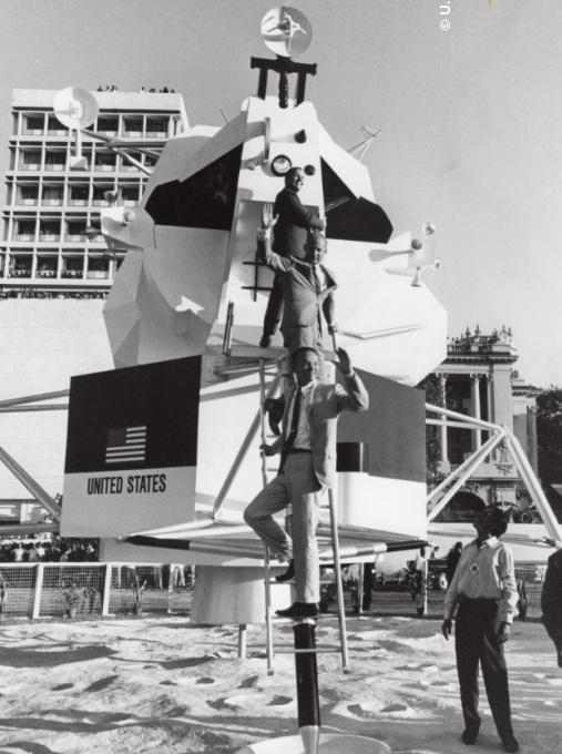 The Department of State and USIA worked to ensure the world was well aware of the U.S. space program. This was accomplished through full-scale models of the lunar module including one visited by the Apollo 11 crew at a USIA exhibit in Bombay, India.