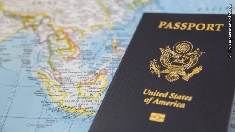 A U.S. passport is pictured on a world map.