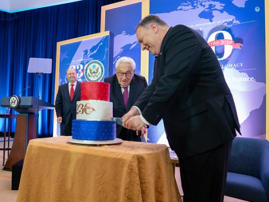 Secretary Pompeo cuts a celebratory cake with former Secretary of State Dr. Henry Kissinger. (State Department Photo by Ron Przysucha)