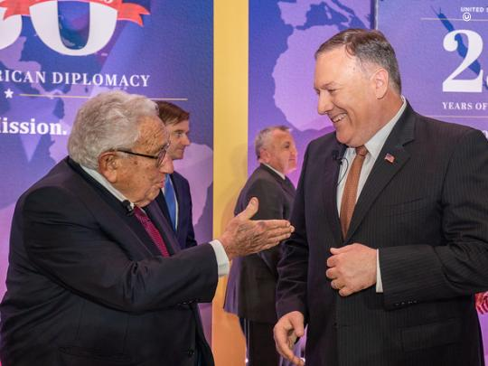 Secretary Pompeo chats with Dr. Henry Kissinger, the 56th Secretary of State, at the Department's 230th anniversary celebration. (State Department Photo by Ron Przysucha)